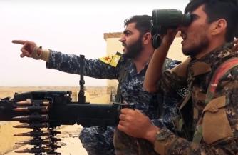 Подготовленные американскими военными курды защищают террористов ИГ от сирийской армии
